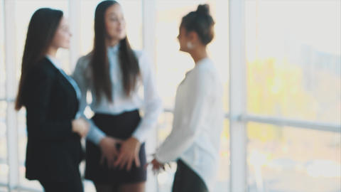 Three business girls chatting smiling when they succeed in business. Teamwork Footage