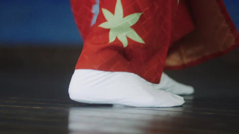 """Close-up of the feet of """"Okame"""" dancing in Japanese traditional Kagura Mai ビデオ"""