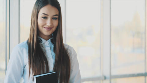 Business girl is happy to be successful in business. Teamwork Ideas to Footage