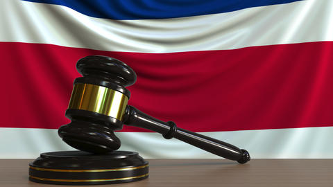 Judge's gavel and block against the flag of Costa Rica. National court Live Action