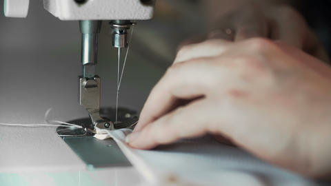 Close Up Shot of Female Hands Working on Sewing Machine. Young Woman Concept Live Action