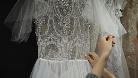 Bride at The Clothes Shop for Wedding Dresses She is Choosing a Dress Footage
