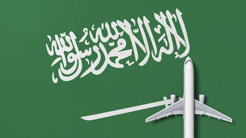 Commercial airplane on the flag of Saudi arabia. Travel related conceptual 3D Live Action