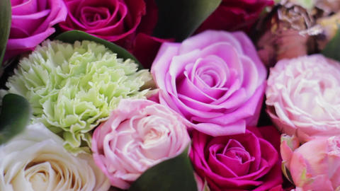 Large rotating bouquet of roses in multi-colored light Footage