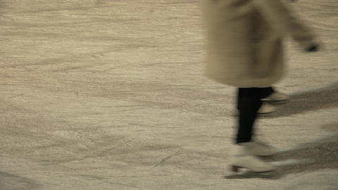 People skate on the ice rink, filled with ice Footage