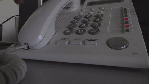 Dialing a number on the office landline Footage