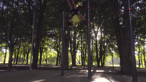 The guy does rise with a revolution on a horizontal bar Footage