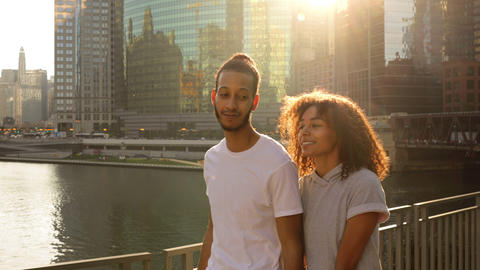 Cute African American couple walk together along the Chicago River Footage