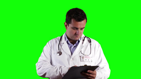 Young Doctor Checking Papers Greenscreen 21 Stock Video Footage