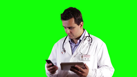 Young Doctor Tablet PC Cell Phone Bad News Greenscreen 20 Stock Video Footage