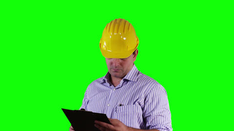 Young Engineer Checking Documents and Signs Greenscreen 22 Stock Video Footage