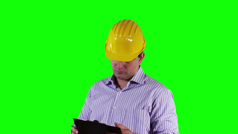 Young Engineer Checking Documents and Signs Greenscreen 22 Footage