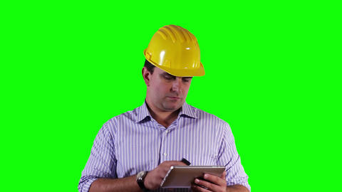 Young Engineer Tablet PC Cell Phone Greenscreen 17 Stock Video Footage