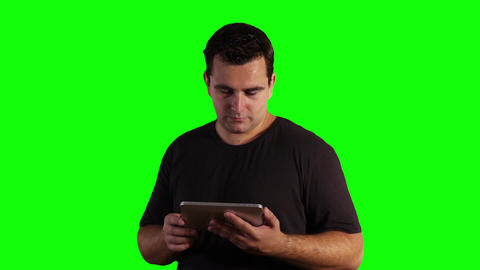 Young Man Tablet PC Bad News Greenscreen 10 Stock Video Footage