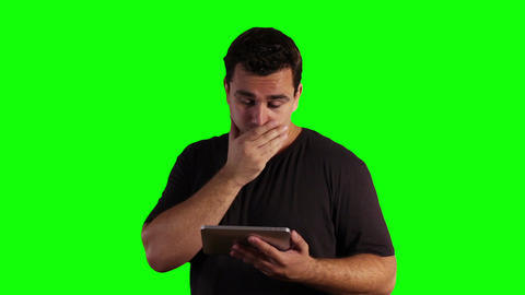 Young Man Tablet PC Bad News Greenscreen 10 Footage