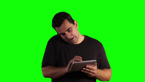 Young Man Tablet PC Cell Phone Greenscreen 16 Stock Video Footage