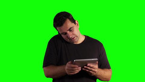 Young Man Tablet PC Cell Phone Greenscreen 16 Footage