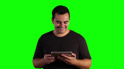 Young Man Tablet PC Good News Greenscreen 12 Stock Video Footage