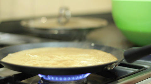 Preparation of pancakes on frying pan Stock Video Footage