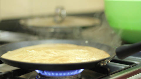 Preparation of pancakes on frying pan Footage