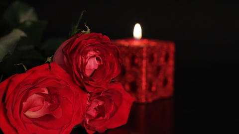 Red rose and candle Stock Video Footage