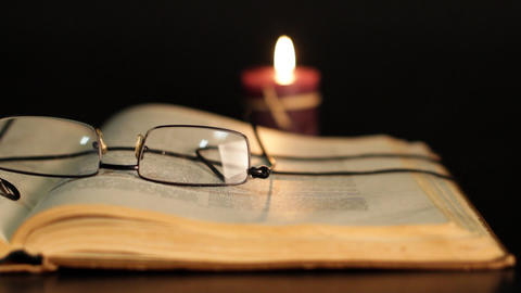 book, glasses and candle Stock Video Footage