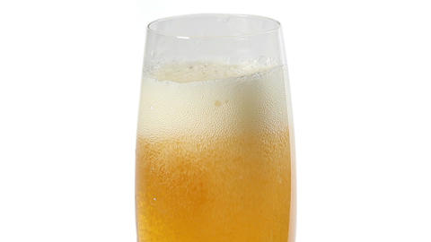 Cider with bubbles in glass isolated on white Stock Video Footage