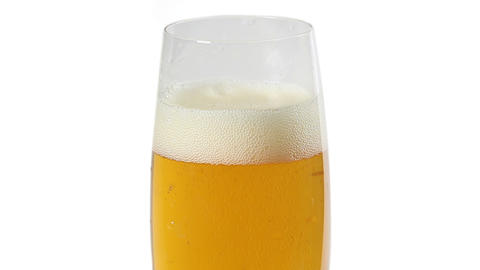 Cider with bubbles in glass isolated on white Footage