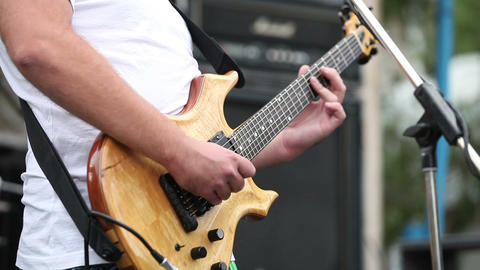Male guitar player performing song on instrument Footage