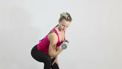Athletic young woman working with dumbbell isolated on white Stock Video Footage