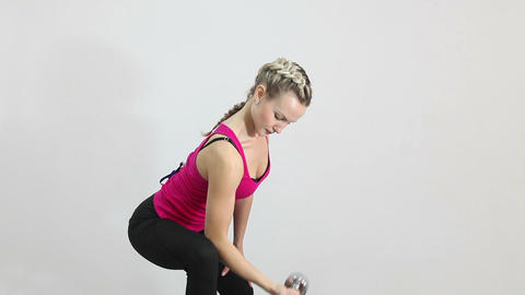 Athletic young woman working with dumbbell isolated on white Footage