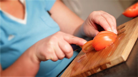 Cutting of tomato for salad Stock Video Footage