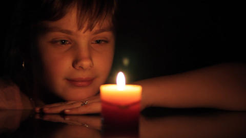 girl and candle Stock Video Footage
