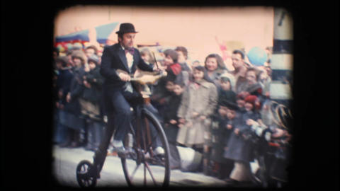 Vintage 8mm. Man riding velocipede Stock Video Footage