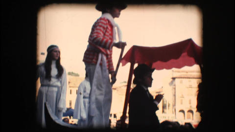 Vintage 8mm. Children in costume riding a float Footage