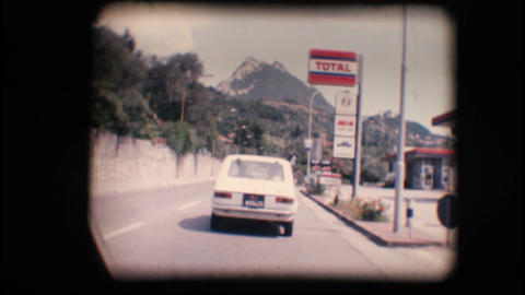 Vintage 8mm. Camera car following a car Stock Video Footage