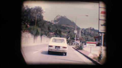 Vintage 8mm. Camera car following a car Footage