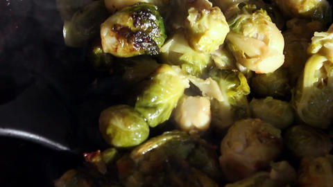 Chef stiring brussels sprouts on a frying-pan Footage