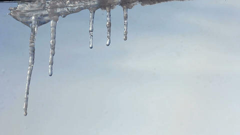 Icicles festoon the eaves - timelapse Stock Video Footage