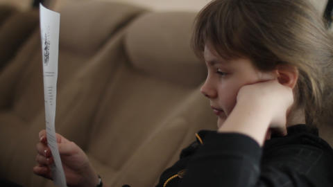 girl attentively reads Footage