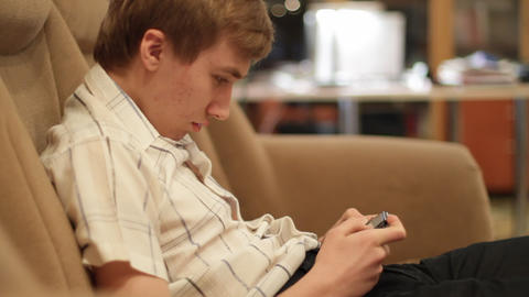 teenager plays game Stock Video Footage