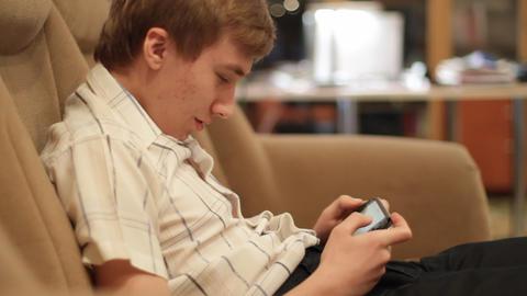 teenager plays game Footage