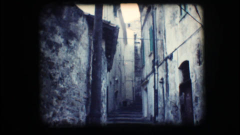 Vintage 8mm. Narrow Alley stock footage