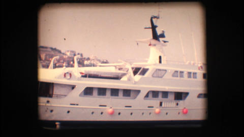 Vintage 8mm. Docked yacht Stock Video Footage