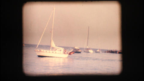 Vintage 8mm. Boats at port entrance Stock Video Footage