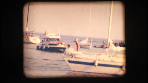 Vintage 8mm. Boats At Port Entrance stock footage
