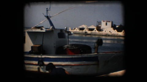Vintage 8mm. Docked fishing boats Footage