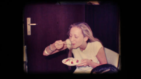 Vintage 8mm. Young woman eating cake Stock Video Footage