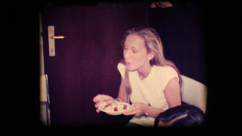 Vintage 8mm. Young woman eating cake Footage