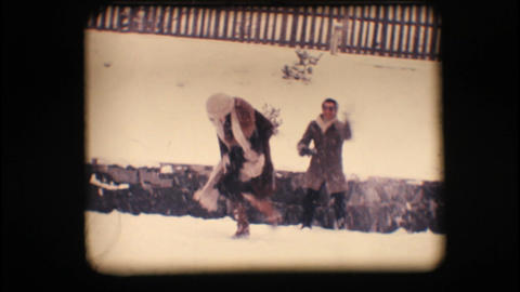 Vintage 8mm. Friends playing with snow Stock Video Footage